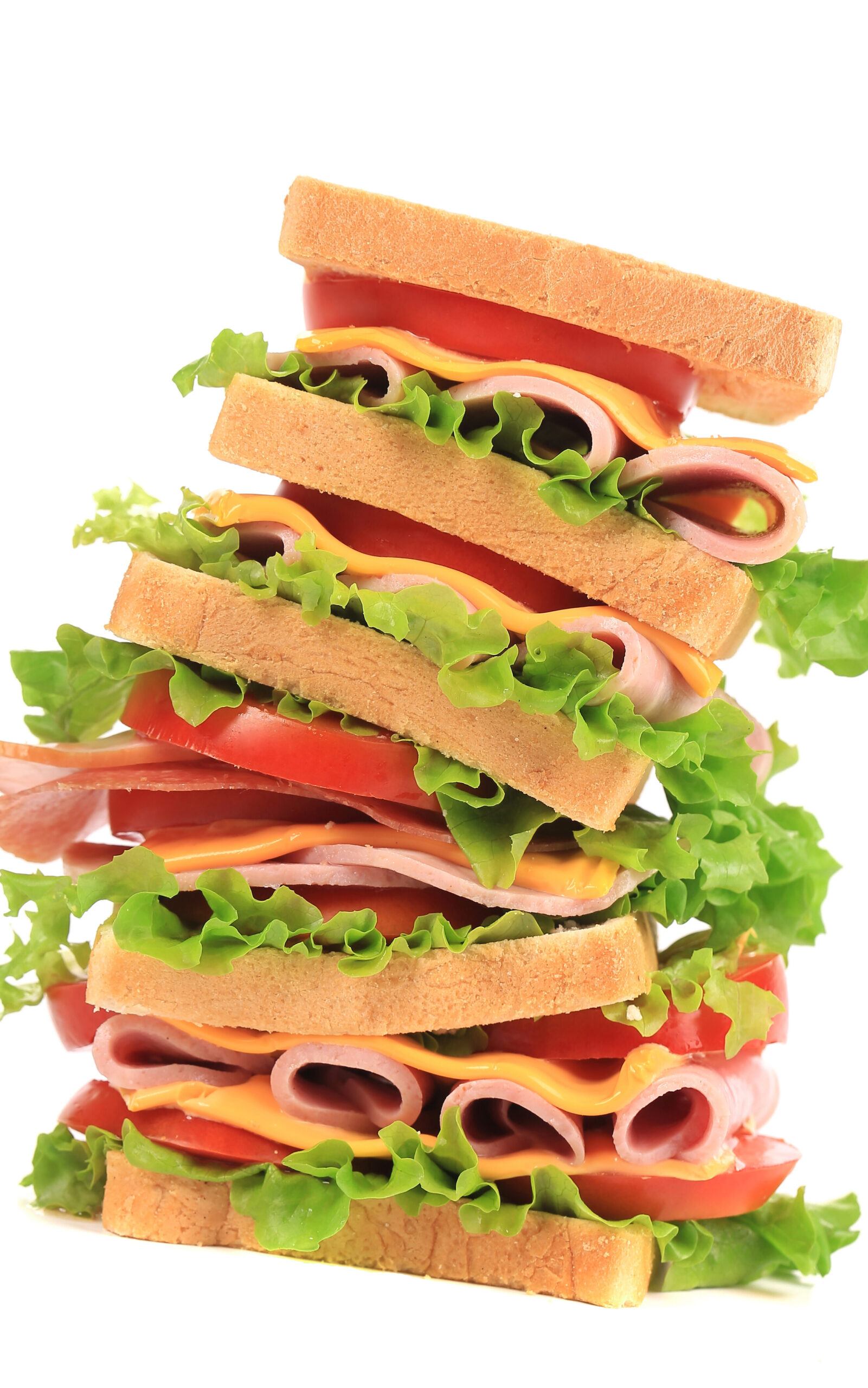 A very tall sandwich! Six slices of bread with tomato, cheese, meat, and lettuce between each pair.